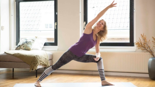 Esther Ekhart in extended side angle pose