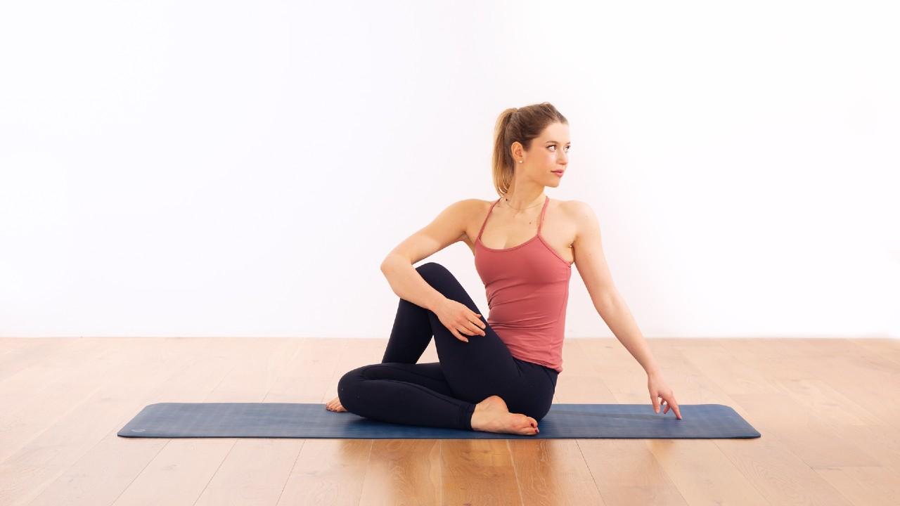 Yoga teacher in seated twist