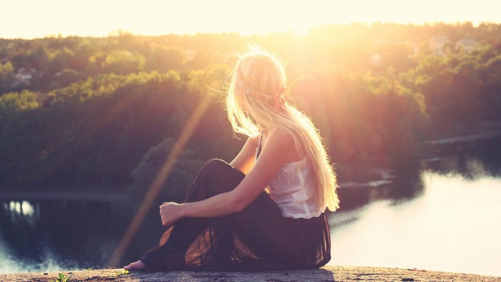 Girl overlooking lake view