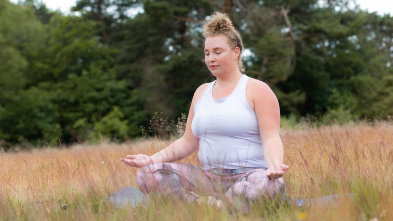 Woman outside doing Loving Kindness Meditation