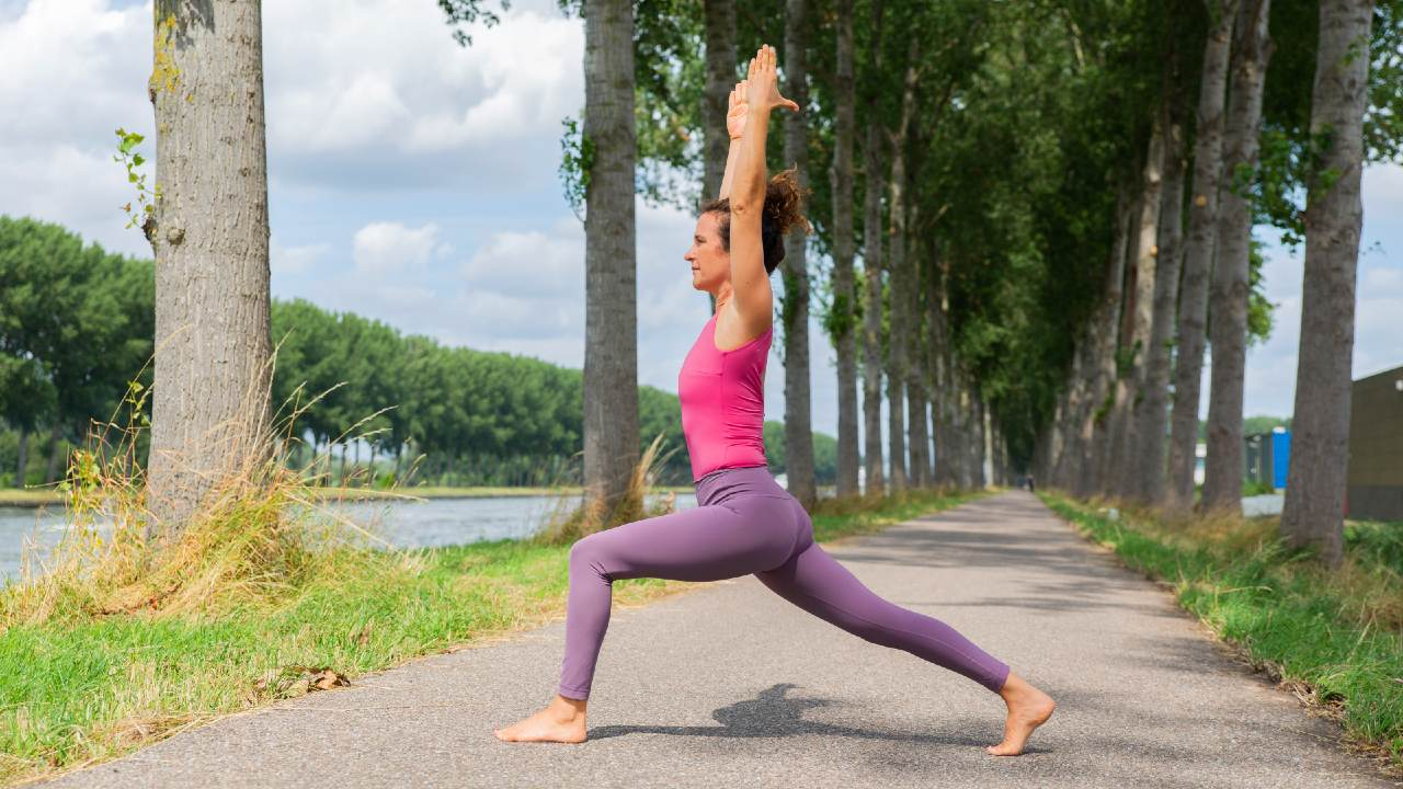 Woman in Warrior yoga pose for part of your Power hour morning
