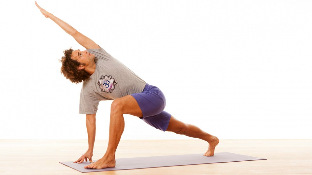 Svadhyaya David Lurey in twisted lunge pose