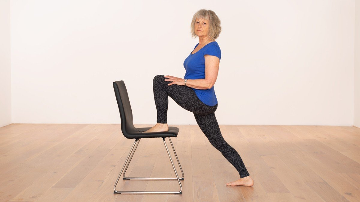 Lunge pose with a chair