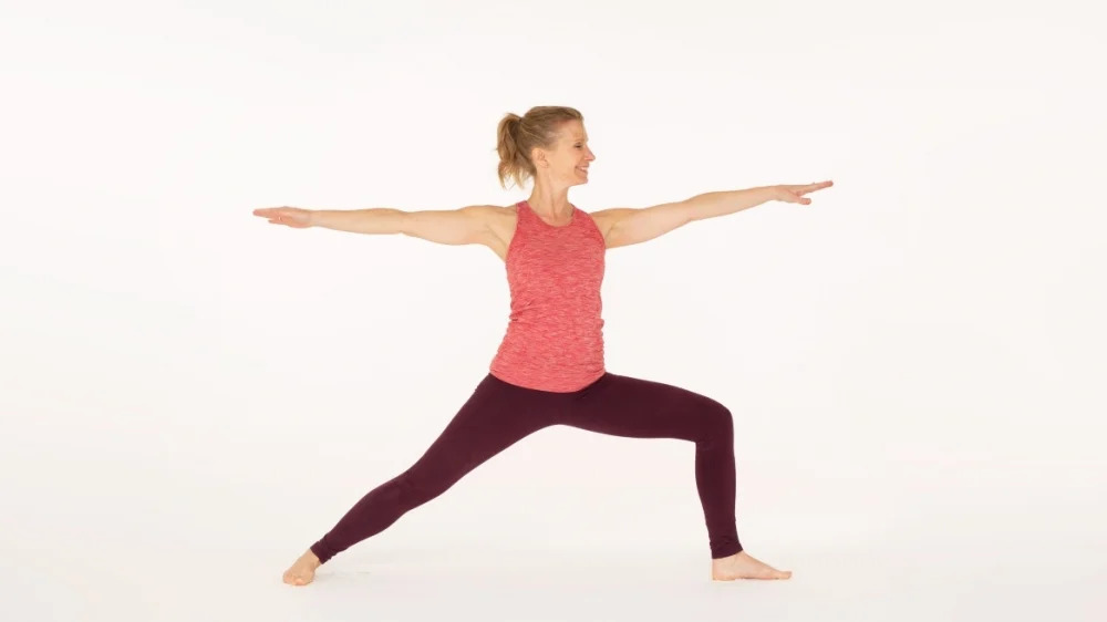 Warrior 2 yoga pose Virabhadrasana II Ekhart Yoga
