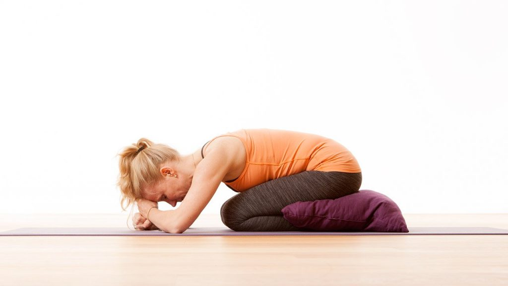 Balasana with head and hips supported