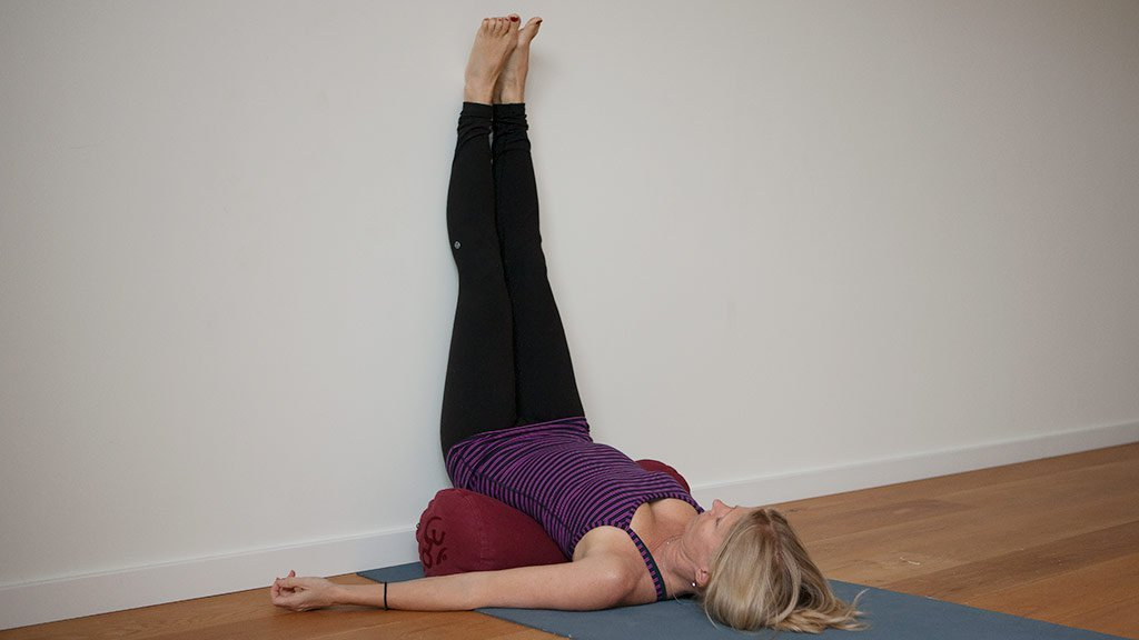 Legs up the wall pose to balance the third eye chakra